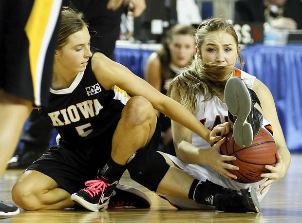 Kiowa's Addy Clift (5), left, tries to take the ball from Cheyenne=Reydon's Morgan Latta (5) during a Class A girls semifinal game of the state high school basketball tournament between Cheyenne-Reydon and Kiowa at Jim Norick Arena, The Big House, on State Fair Park in Oklahoma City, Friday, March 1, 2013. Photo by Nate Billings, The Oklahoman