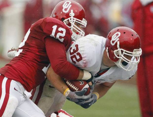 Austin Box, left, makes a tackle during OU's spring football game in April. <strong>STEVE SISNEY - The Oklahoman</strong>