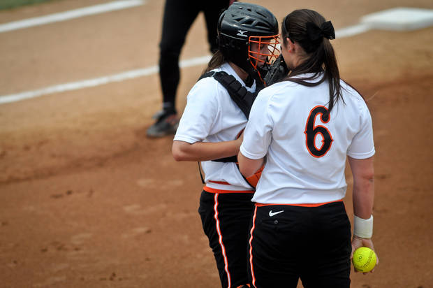 Oklahoma State catcher Tamara Brown (left) and pitcher Kat Espinosa (right) have a meeting on the mound in the final game of the seasons Bedlam series held in Stillwater, Okla. on May 12, 2013.  KT King/For the Oklahoman KOD