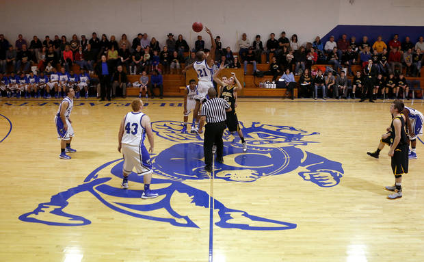 HIGH SCHOOL BASKETBALL: The Coyle team controls the tip during the start of their basketball game against Mulhall-Orlando in Coyle, Okla., Tuesday, Jan. 22, 2013. Coyle High School hosted its final regular season basketball game in its current gym that was finished in 1939. Photo by Bryan Terry, The Oklahoman