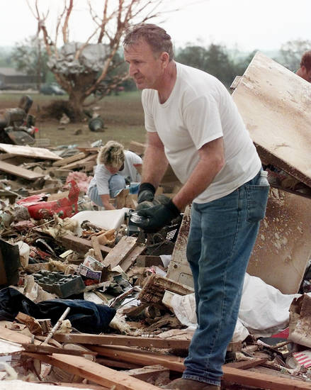 MAY 3, 1999: Tornado damage, victims: Henry Mobley, a Newcastle homeowner, sifts through the remains of his house destroyed by Monday's tornado.