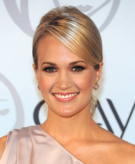 American singer Carrie Underwood is announced as the first ever North American spokesperson for Olay beauty products on Wednesday, Sept. 8, 2010 in New York. (AP Photo/Evan Agostini) ORG XMIT: NYEA103
