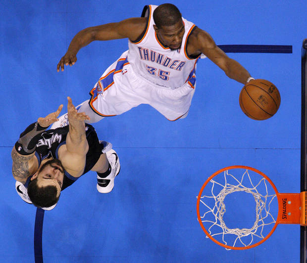 Oklahoma City's Kevin Durant (35) goes past Minnesota's Nikola Pekovic (14) during an NBA basketball game between the Oklahoma City Thunder and the Minnesota Timberwolves at Chesapeake Energy Arena in Oklahoma City, Wednesday, Jan. 9, 2013.  Oklahoma City won 106-84. Photo by Bryan Terry, The Oklahoman