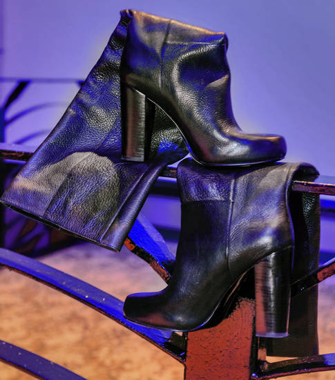 These tall Nine West leather boots are part of the shoe collection at Nearly New, a consignment shop in Oklahoma City. Nearly New has a large selection of used formals, wedding gowns and men's and women's separates and accessories. Photo by Chris Landsberger, The Oklahoman. <strong>CHRIS LANDSBERGER</strong>