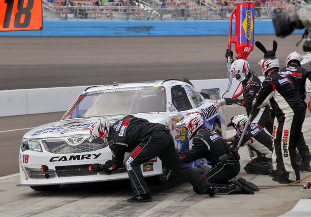 Pole-sitter Joey Logano makes a pit stop during the NASCAR Nationwide Series auto race, Saturday, Nov. 10, 2012, at Phoenix International Raceway in Avondale, Ariz. (AP Photo/Matt York)