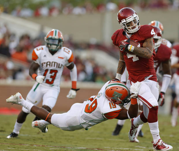 Oklahoma's Kenny Stills (4) fights off Florida A&M Rattlers defensive back Jonathan Pillow (19) during the college football game between the University of Oklahoma Sooners (OU) and Florida A&M Rattlers at Gaylord Family-Oklahoma Memorial Stadium in Norman, Okla., Saturday, Sept. 8, 2012. Photo by Bryan Terry, The Oklahoman