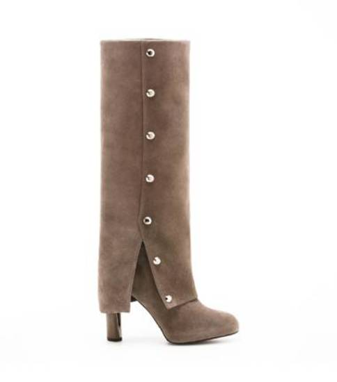 IN THE FASHION FOLD - The stylish overlap design details makes these knee boots a chic option for fall from Stuart Weitzman.