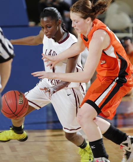 Northeast's Lanesia Williams (1) steals the ball from Fairview's Olivia Mason (25) during the state high school basketball tournament Class 2A girls semifinal game between Fairview High School and Northeast High School at the State Fair Arena on Friday, March 8, 2013, in Oklahoma City, Okla. Photo by Chris Landsberger, The Oklahoman