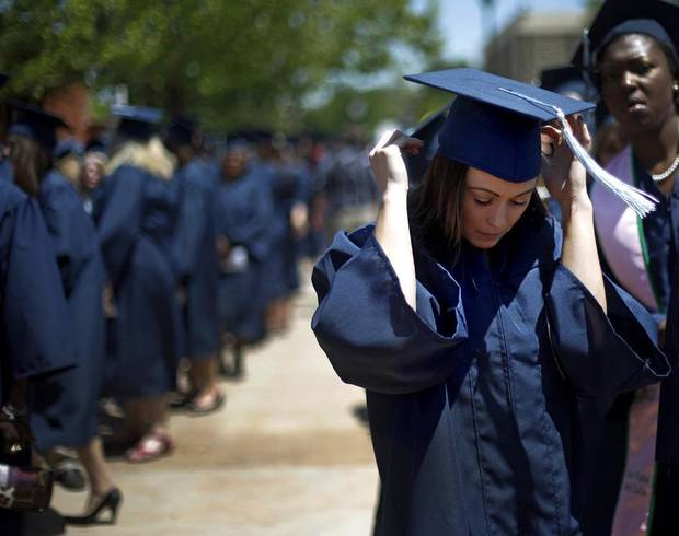 Tatum Parham adjusts her cap before University of Central Oklahoma graduation ceremonies at UCO on Friday, May 6, 2011. Photo by Bryan Terry, The Oklahoman ORG XMIT: KOD