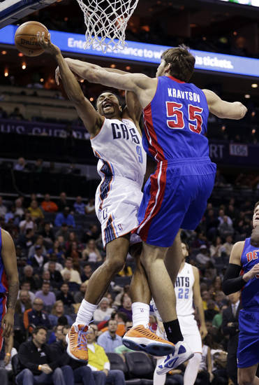 Charlotte Bobcats' Gerald Henderson (9) is fouled by Detroit Pistons' Viacheslav Kravtsov (55) during the first half of an NBA basketball game in Charlotte, N.C., Wednesday, Feb. 20, 2013. (AP Photo/Chuck Burton)