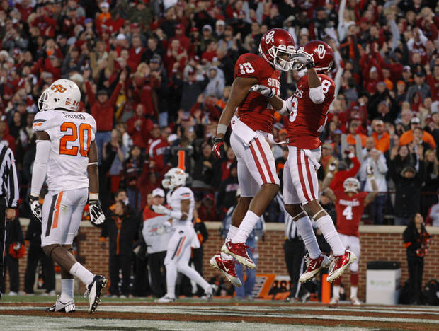 Oklahoma's Justin Brown (19) and Jalen Saunders (18) celebrate after a two-point conversion during the Bedlam college football game between the University of Oklahoma Sooners (OU) and the Oklahoma State University Cowboys (OSU) at Gaylord Family-Oklahoma Memorial Stadium in Norman, Okla., Saturday, Nov. 24, 2012. Oklahoma won 51-48. Photo by Bryan Terry, The Oklahoman