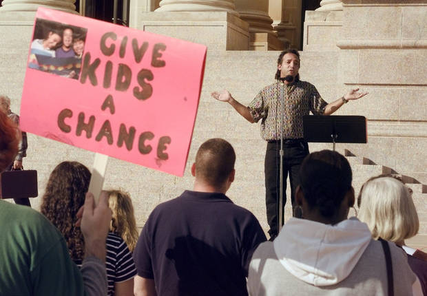 Social work professor and accused child sex abuser Dwain Pellebon is shown addressing some 40 other concerned individuals in a 1997 rally on the south steps of the state capitol to protest proposed welfare cuts in the state Temporary Assistance for Needy Families program.. <strong>ROGER KLOCK - THE OKLAHOMAN</strong>