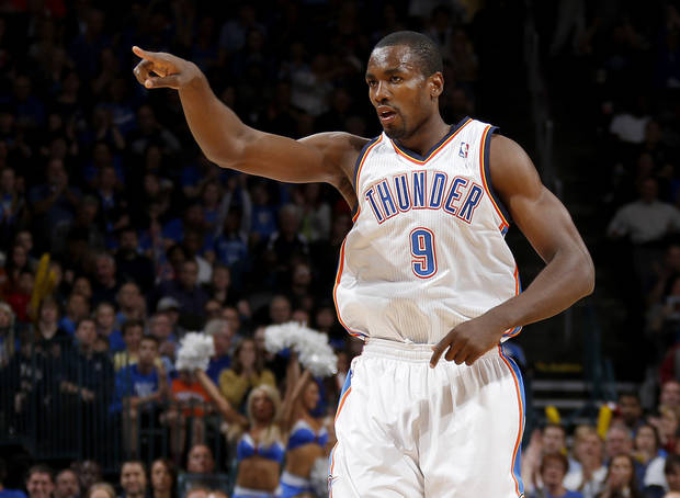 Oklahoma City's Serge Ibaka (9) celebrates after a basket during an NBA basketball game between the Oklahoma City Thunder and the Toronto Raptors at Chesapeake Energy Arena in Oklahoma City, Tuesday, Nov. 6, 2012.  Tuesday, Nov. 6, 2012. Oklahoma City won 108-88. Photo by Bryan Terry, The Oklahoman