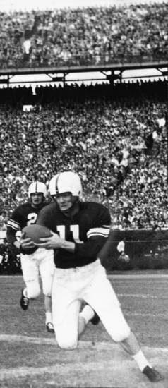 """This Sugar Bowl action photo shows the University of Oklahoma's Darrell Royal as he picks up nine yards in the first quarter of Monday's Sugar bowl game in New Orleans against Louisiana State.  Royal started on the Oklahoma 30-yard line and was halted on the 39 by LSU's Jack Cole, a quarterback.   OU won the game, 35-0."" The University of Oklahoma Sooners downed the Louisiana State University Tigers 35-0 in the Sugar Bowl in New Orleans. Staff photo via AP Wirephoto taken by George Tapscott 1/2/50; photo ran in the 1/3/50 Oklahoma City Times. File:  College Football/OU/OU-Louisiana State/Sugar Bowl/Darrell Royal/1950"