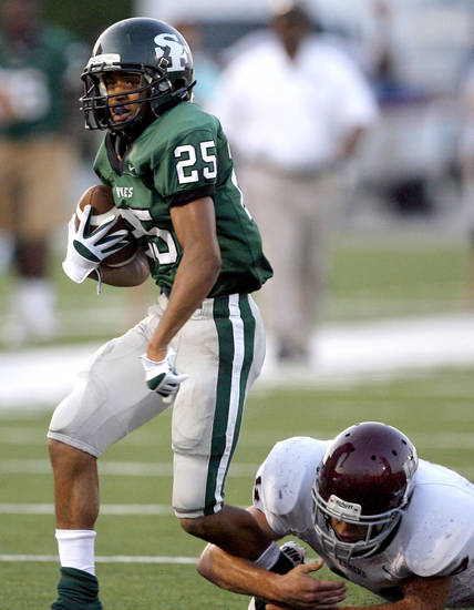 Edmond Santa Fe's Dale Jefferson slips past Edmond Memorial's Matt Hickman during the high school football game between Edmond Santa Fe and Edmond Memorial at Wantland Stadium in Edmond, Okla.,  Friday, Sept. 2, 2011. Photo by Sarah Phipps, The Oklahoman