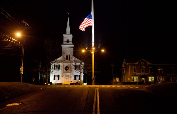 A U.S. flag flies at half-staff on Main Street in honor of the people killed when a gunman opened fire inside a Connecticut elementary school, Saturday, Dec. 15, 2012, in Newtown, Conn. (AP Photo/David Goldman) ORG XMIT: CTDG103