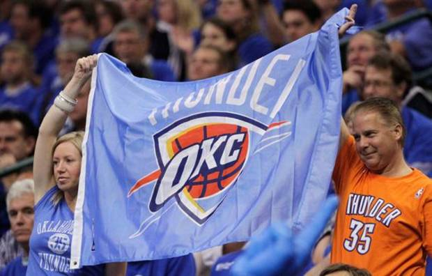 Oklahoma City Thunder fans hold up a flag during the first half of Game 5 of the NBA basketball Western Conference \inals against the Dallas Mavericks on Wednesday, May 25, 2011, in Dallas. (AP Photo/Tony Gutierrez)