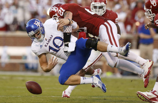 KU's Dayne Crist (10) fumbles the ball as OU's Tom Wort (21) brings him down during the college football game between the University of Oklahoma Sooners (OU) and the Kansas Jayhawks (KU) at Gaylord Family-Oklahoma Memorial Stadium in Norman, Okla., Saturday, Oct. 20, 2012. Photo by Bryan Terry, The Oklahoman