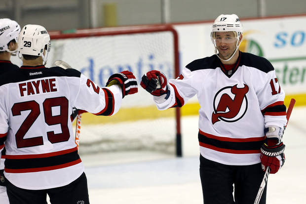 New Jersey Devils left wing Ilya Kovalchuk, right, of Russia, gives a fist-bump to Mark Fayne during a scrimmage against the Albany Devils, the team's AHL farm team, Wednesday, Jan. 16, 2013, in Newark, N.J. (AP Photo/Julio Cortez)