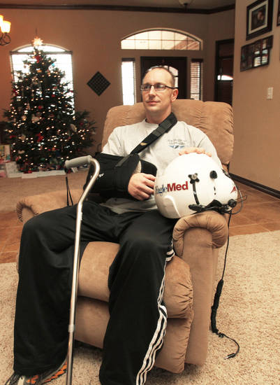 Michael Eccard in his Edmond home Dec. 16, 2010, five months after he survived a fatal helicopter crash. Photo by Jim Beckel, The Oklahoman <strong>JIM BECKEL - THE OKLAHOMAN</strong>