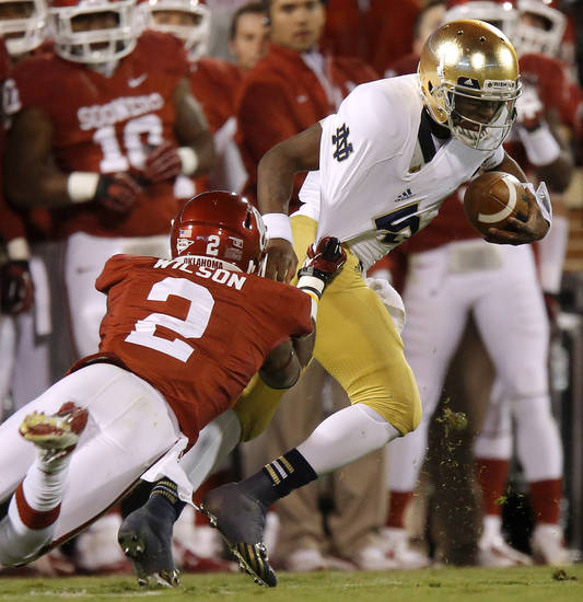 Notre Dame's Everett Golson (5) runs past OU's Julian Wilson (2) during the college football game between the University of Oklahoma Sooners (OU) and the Notre Dame Fighting Irish at Gaylord Family-Oklahoma Memorial Stadium in Norman, Okla., Saturday, Oct. 27, 2012. Oklahoma lost 30-13. Photo by Bryan Terry, The Oklahoman