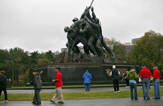 Veterans and volunteers from Oklahoma walk around the Marine Corps War Memorial in Arlington, Virginia on Wednesday, Oct. 12, 2011. Veterans from Oklahoma visited the National WWII Memorial during an Oklahoma Honor Flight to Virginia and Washington D.C. on Wednesday. Photo by John Clanton, The Oklahoman