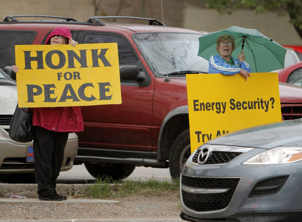 Fannie Bates, left, and Mary Francis were taking part in a protest at Reno and E.K. Gaylord on the drive home Wednesday, March 21, 2012. Photo by Doug Hoke, The Oklahoman
