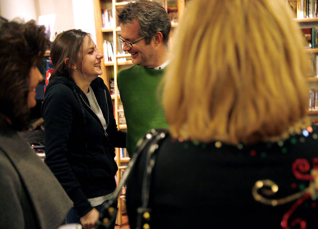 Maddye Chastain talks with her father, Jim, during his birthday party at Full Circle Bookstore in Oklahoma City on Dec. 10, 2008. By John Clanton, The Oklahoman