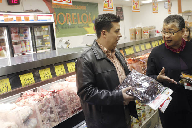 Tulsa manager Manuel Gomez talks about spices with Small Business Administration Deputy Administrator Marie Johns while touring Supermercados Morelos in Oklahoma City, November 30, 2011. Photo by Doug Hoke, The Oklahoman