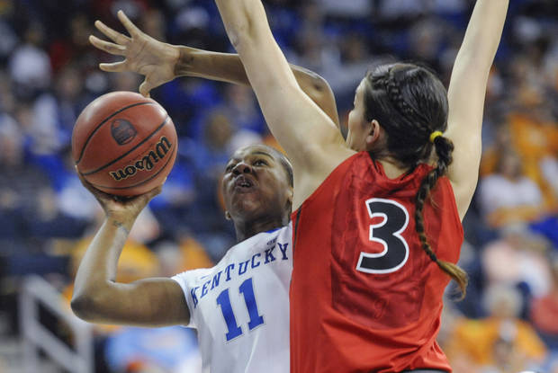 Kentucky center DeNesha Stallworth (11) shoots as Georgia's Anne Marie Armstrong (3) defends during the first half of an NCAA college basketball game in the Southeastern Conference women's tournament, Saturday, March 9, 2013, in Duluth, Ga. (AP Photo/John Amis)