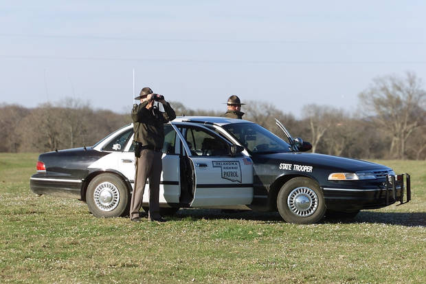 ARCHIVE PHOTO: Oklahoma State Troopers second Lt. Byron Lamb & Trooper Steve Payne look for two Stringtown -  Mack Alford Correctional Center escapees 2 &1/2 miles south of Stringtown, The escapees ditched their stolen car in the hills near Boggy creek .  Staff Photo By Steve Gooch /  The Oklahoman