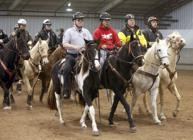 Riders and their horses move in formation during an annual training event to qualify deputies and horses for the Oklahoma County Sheriff's Office Mounted Patrol Division at State Fair Park in Oklahoma City, OK, Saturday, March 5, 2011. By Paul Hellstern, The Oklahoman ORG XMIT: KOD