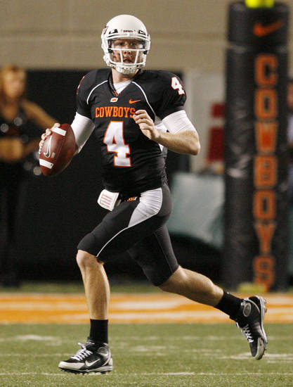 OSU's Brandon Weeden (4) looks for a receiver during the college football game between Oklahoma State University (OSU) and the University of Colorado (CU) at Boone Pickens Stadium in Stillwater, Okla., Thursday, Nov. 19, 2009. OSU won, 31-28. Photo by Nate Billings, The Oklahoman