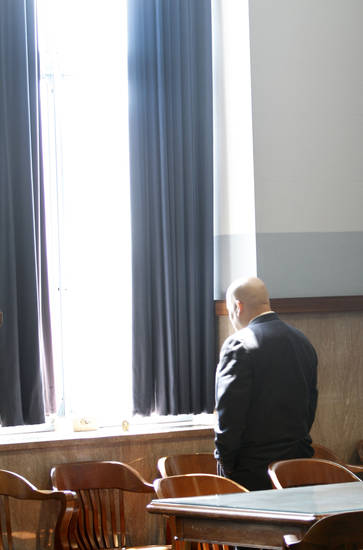 Former Oklahoma City police  Sgt. Maurice A. Martinez looks out a window Tuesday in a courtroom at the Oklahoma County Courthouse. Martinez pleaded guilty to sexual abuse charges involving  his three adopted sons and  was sentenced to two years in county jail.  Photos By Steve Gooch, The Oklahoman