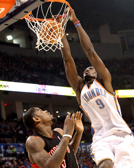 Oklahoma City's Serge Ibaka slams in a basket over Toronto's Amir Johnson during their NBA basketball game at the Ford Center in Oklahoma City on Sunday, Feb. 28, 2010. Photo by John Clanton, The Oklahoman