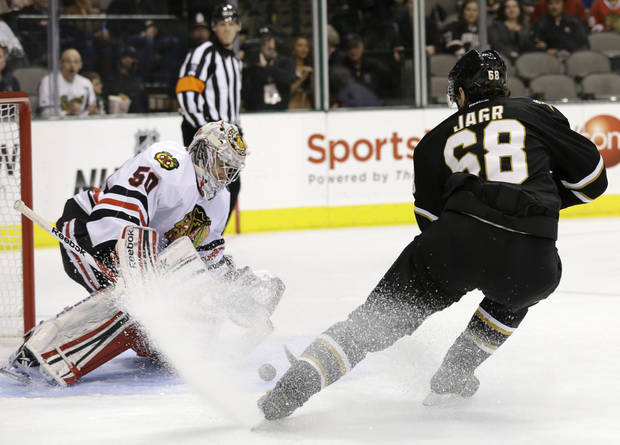 Chicago Blackhawks goalie Corey Crawford (50) defends against a shot by Dallas Stars' Jaromir Jagr (68), of the Czech Republic, in the first period of an NHL hockey game, Thursday, Jan. 24, 2013, in Dallas. (AP Photo/Tony Gutierrez)