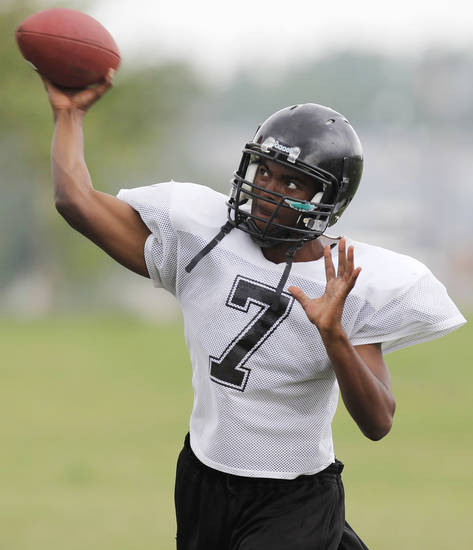 Chris Compton looked good in spring practice (pictured here) and summer workouts as he tries to take over the quarterback job for defending Class 4A state champion Douglass.