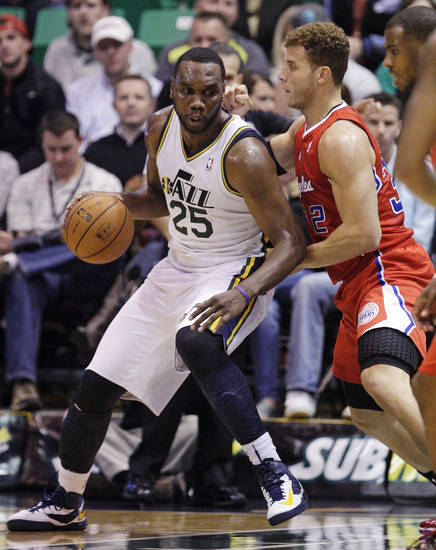 Los Angeles Clippers power forward Blake Griffin, right, defends against Utah Jazz center Al Jefferson (25) in the first quarter of an NBA basketball game, Monday, Dec. 3, 2012, in Salt Lake City. (AP Photo/Rick Bowmer)