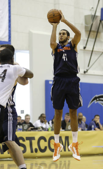 Oklahoma City Thunder's Grant Jerrett (47) takes a shot over Orlando Magic's Andrew Nicholson, left, during an NBA summer league basketball game, Monday, July 8, 2013, in Orlando, Fla. (AP Photo/John Raoux) ORG XMIT: DOA106