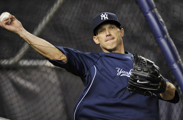 New York Yankees manager Joe Girardi throws during a baseball practice Friday, Oct. 5, 2012, at Yankee Stadium in New York. (AP Photo/Bill Kostroun)