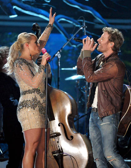 Recording artists Miranda Lambert, left, and Dierks Bentley perform at the 55th annual Grammy Awards on Sunday, Feb. 10, 2013, in Los Angeles. (Photo by John Shearer/Invision/AP) ORG XMIT: CASH145