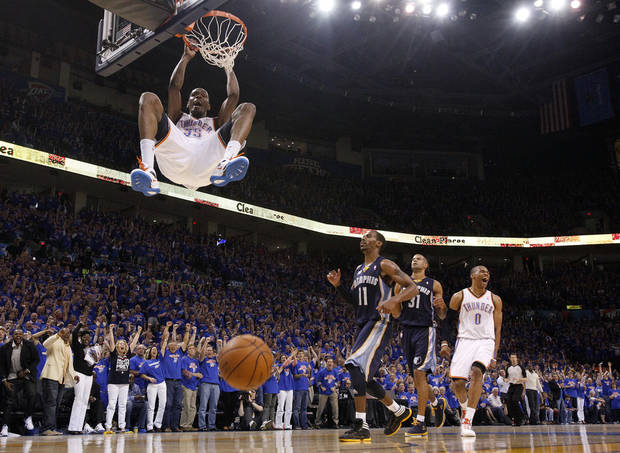Oklahoma City's Kevin Durant (35) dunks the ball as Russell Westbrook (0) celebrates near Mike Conley (11) and Shane Battier (31) of Memphis in the fourth quarter during game 7 of the NBA basketball Western Conference semifinals between the Memphis Grizzlies and the Oklahoma City Thunder at the OKC Arena in Oklahoma City, Sunday, May 15, 2011. Photo by Sarah Phipps, The Oklahoman
