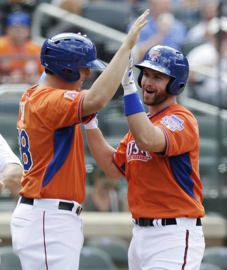 United States� Matt Davidson, right, celebrates with C.J. Cron after hitting a home run in the fourth inning of the All-Star Futures Game on Sunday. AP Photo