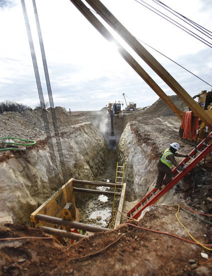 CONSTRUCTION: Workers use heavy machinery to install sections of the Keystone Pipeline south of Cushing, OK, Tuesday, January 15, 2013,  By Paul Hellstern, The Oklahoman