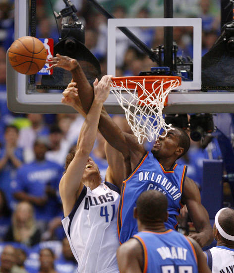 Oklahoma City's Serge Ibaka (9) blocks the shot of Dallas' Dirk Nowitzki (41) during Game 4 of the first round in the NBA playoffs between the Oklahoma City Thunder and the Dallas Mavericks at American Airlines Center in Dallas, Saturday, May 5, 2012. Photo by Bryan Terry, The Oklahoman