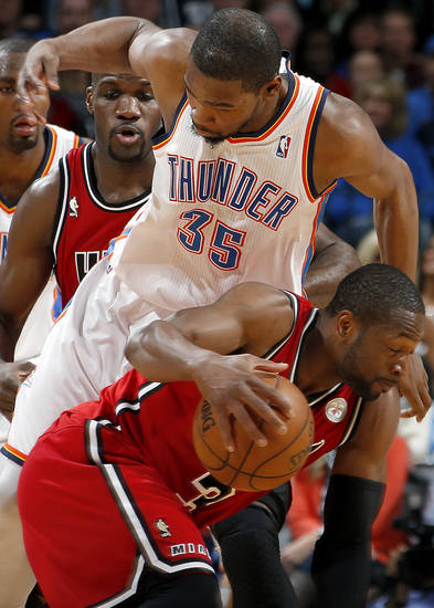 Miami's Dwyane Wade (3) tries to get by Oklahoma City's Kevin Durant (35) during an NBA basketball game between the Oklahoma City Thunder and the Miami Heat at Chesapeake Energy Arena in Oklahoma City, Thursday, Feb. 15, 2013. Miami won 110-100. Photo by Bryan Terry, The Oklahoman