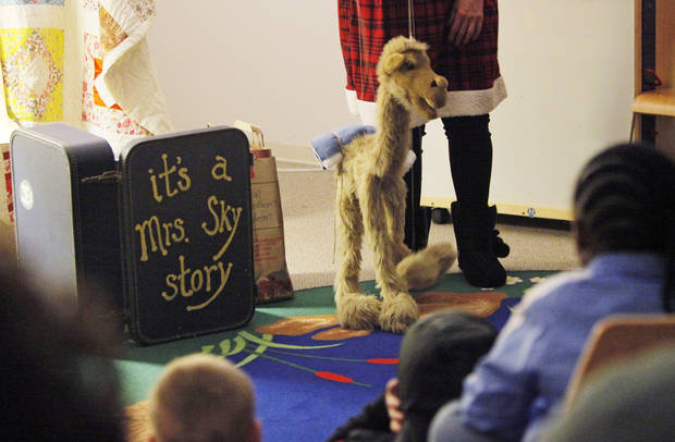 Children watch Clyde the camel during an It's a Mrs. Sky Story puppet show at the Choctaw Library in Choctaw, Okla., Monday, Dec. 19, 2011. Photo by Nate Billings, The Oklahoman