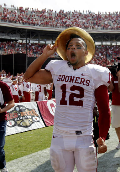 Oklahoma's Travis Lewis celevrates after the Red River Rivalry college football game between the University of Oklahoma Sooners (OU) and the University of Texas Longhorns (UT) at the Cotton Bowl in Dallas, Saturday, Oct. 8, 2011.  Oklahoma won 55-17. Photo by Bryan Terry, The Oklahoman