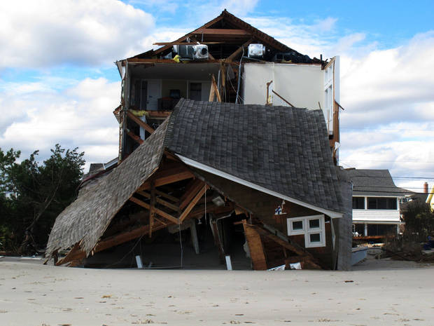 An oceanfront home is destroyed in Mantoloking, N.J., on Oct. 31, 2012. Sandy, the storm that made landfall Monday, caused multiple fatalities, halted mass transit and cut power to more than 6 million homes and businesses. (AP Photo/Wayne Parry) ORG XMIT: RPWP106