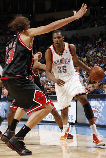 Oklahoma City's Kevin Durant (35) looks to drive the ball past Joakim Noah (13) of Chicago in the first half of the NBA basketball game between the Chicago Bulls and the Oklahoma City Thunder at the Ford Center in Oklahoma City, Wednesday, March 18, 2009. PHOTO BY NATE BILLINGS, THE OKLAHOMAN